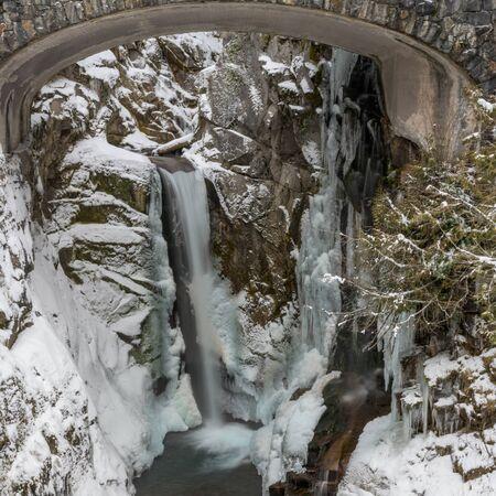 Frozen Christine Falls Below Bridge in winter 版權商用圖片