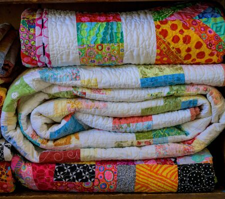 Folded Quilts Stacked in linen closet 版權商用圖片