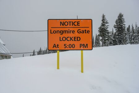Longmire Gate Closing Times in Winter sign
