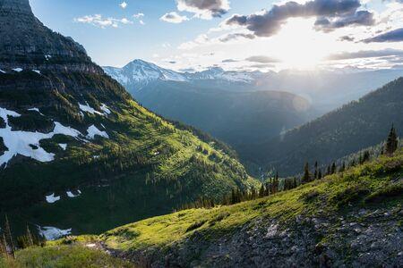 Sun Glows Over Green Montana Mountains Near Logan Pass