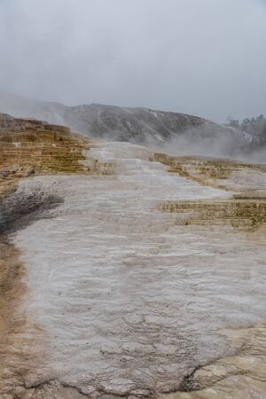 White Residue from Mammoth Hot Springs Covers Mountainside Reklamní fotografie