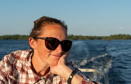 Woman Rests Her Chin on Hand on a Boat ride