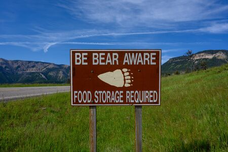 Be Bear Aware Sign Reminds People to Use Proper Food Storage in Wyoming wilderness