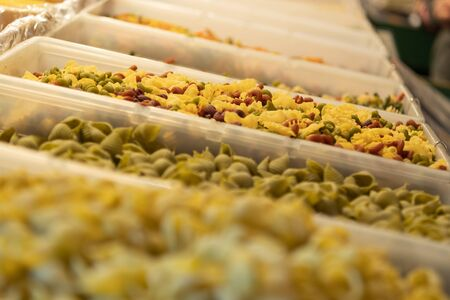 Selective Focus on Assorted Homemade Pastas in Market
