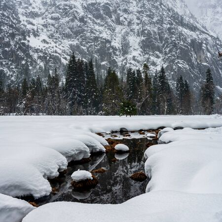 Creek Cuts Through Snow Covered Meadow in Yosemite valley