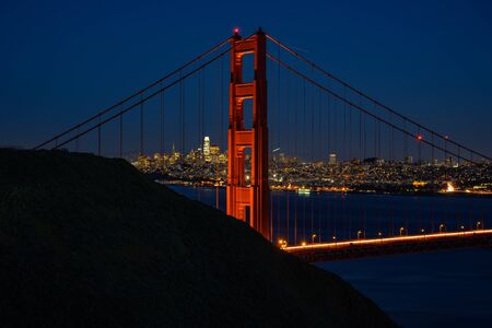 North Tower Of The Golden Gate at Sunset with lights turning on