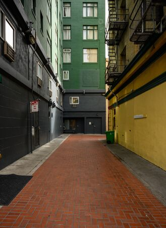 Color Blocking In Alley with brick walkway Stock Photo