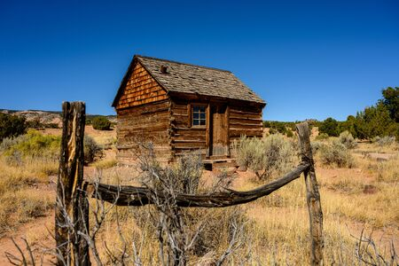 Morrell Line Cabin Framed In Old Fence in Utah desert
