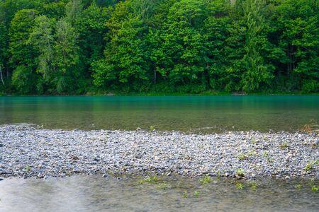 Rocky Beach of aqua river in Washington wilderness