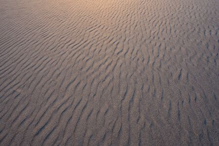Looking Across Rippled Sand with golden light