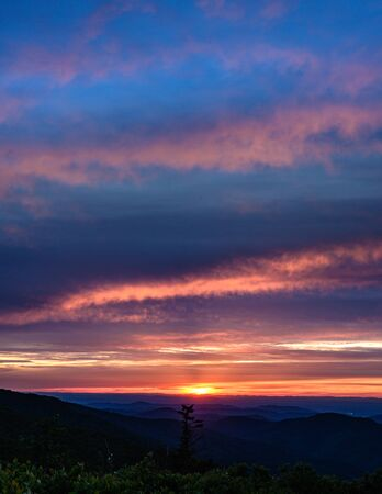 Soft Sunset Light Fades Over Blue Ridge Mountains in summer