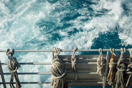 Ropes Tied to Railing over blue waters Foto de archivo