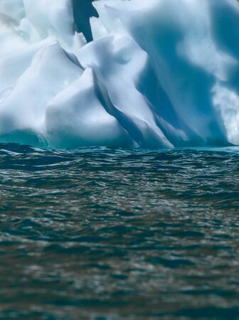 Abstract of Edge of Iceberg on Lake Surface vertical