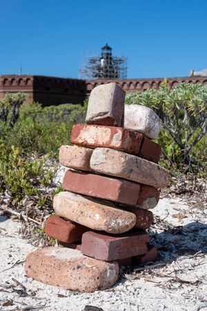 Stack of Old Bricks and Lighthouse Under Repair on Dry Tortugas