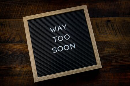 Way Too Soon Message on Letterboard on wooden background
