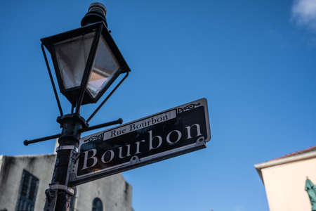 February 27, 2020: Bourbon Street Sign with Lamp Post in the French Quarter