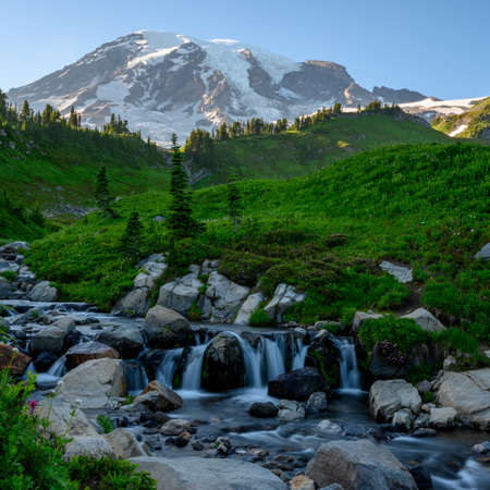 Stream Tumbles Over Rocks with Mount Rainier in background