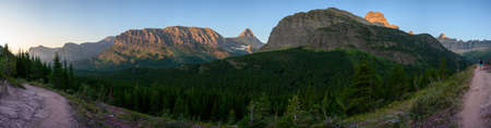 Panorama Of Morning Light Hitting Grinnell Point and Swiftcurrent in summer