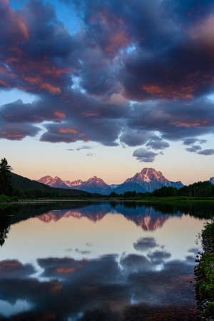 Sunrise Light Hits the Tops of the Teton Range just after sunrise from Oxbow bend