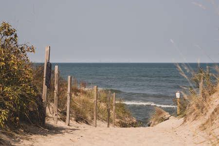 Cresting Over Dunes with Chicago on the Horizon across Lake Michigan 免版税图像