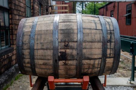 Orange Lift Holds Bourbon Barrel onto rolling rail