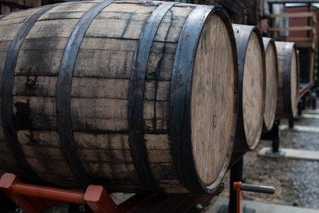 Bourbon barrels wait for transportation to storage area