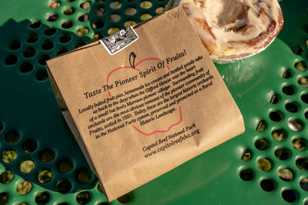 Fuita, United States: August 10, 2020: The Pioneer Spirit of Fruit next to cinnamon roll