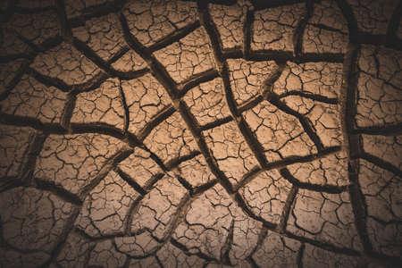 Vignette Effect Over Cracked Mud Background Image