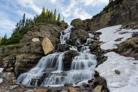 Wide View of Logan Creek Falls in Glacier National Park 免版税图像