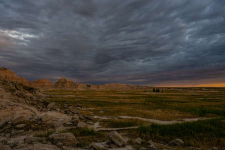Sun Glows on the Horizon of Field in Badlands National Park