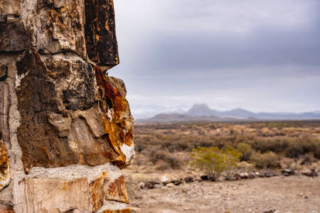Looking Past Petrified Wood fireplace to mountain range in Big Bend National Park