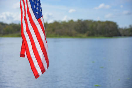 American Flag Hangs Over Water