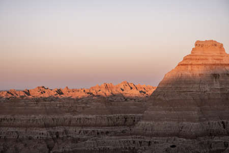 Shadows Fade Over Valley of Hoodoos in Badlands