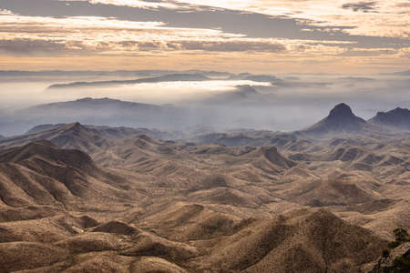 Rolling Hills And Fog South of The Chisos Mountians from the South Rim Trail Stock Photo
