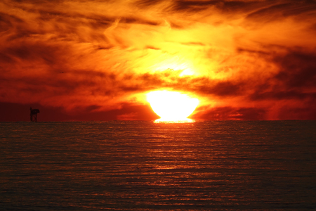 Sunset Gulf Shores Alabama with Oil Rig Stock Photo