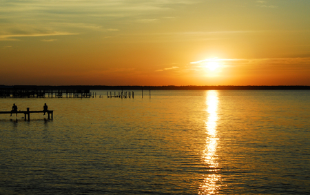 Sunset over Lagoon at Gulf Shores with Dock