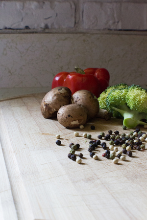 Healthy Eating Vegetables on Wooden Cutting Board, Peppercorns, Red Bell Pepper, Onion, Broccoli, Mushroom
