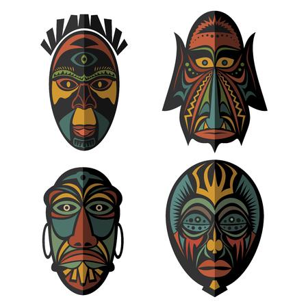 Conjunto de máscaras tribales étnicas africanas en el fondo blanco. . Iconos planos. Símbolos rituales.
