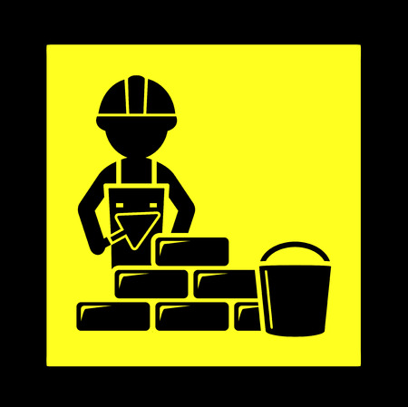 laying: yellow construction icon with builder laying brick wall