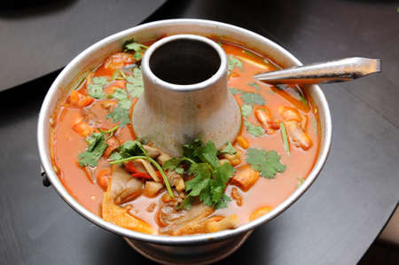 Thai Dishes - Tom Yam Kung. Spicy Shrimp Soup  photo
