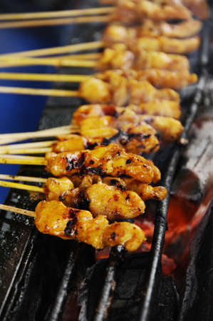 hawker: Satay being grilled on hawker food market