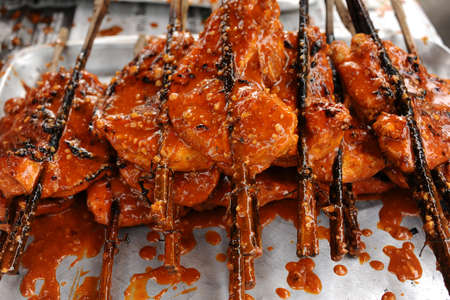 wood stick: Grilled chicken wing with wood stick Stock Photo