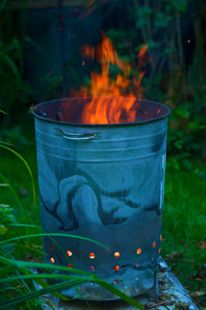 incinerator: Incinerator burning garden waste