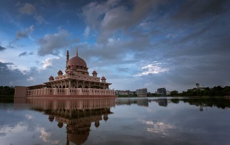 The reflection of a muslim mosque from Malaysia. Фото со стока