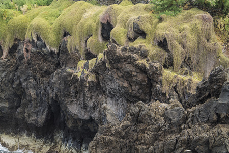 chink: green cliff Stock Photo