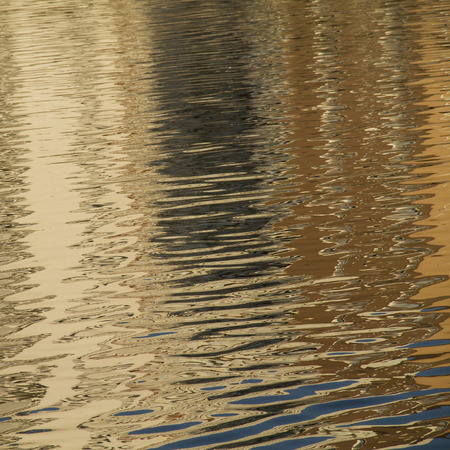 sinuous: nature background of golden  sinuous weaves  in the water of the river