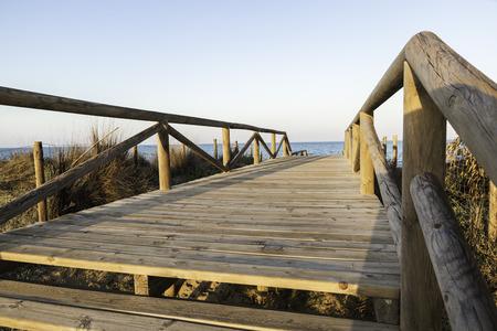 beach access: Bridge of access to the beach across the dunes in Guardamar del Segura- Alicante,Spain