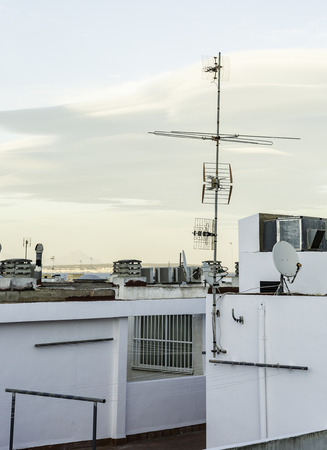 refrigeration: white rooftop with antennas, refrigeration and chimneys