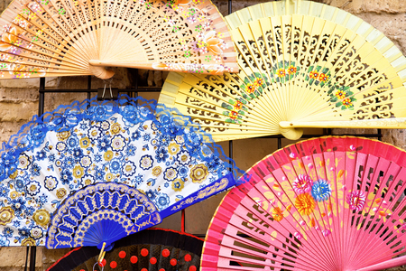 typical  wooden spanish fan  in a market to attack the heat 스톡 콘텐츠