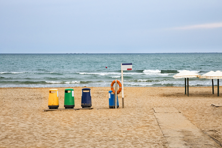 colorful recycle bins in the beach to recycle garbage Stock Photo